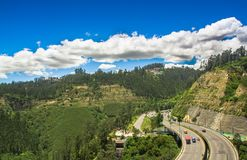 Aerial view of road in the mountains to visit the municipal dump in a beautiful day, in the city of Quito, Ecuador Stock Image