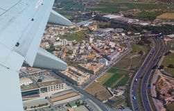 Aerial view with road network. PALMA, MALLORCA, SPAIN - APRIL 24, 2015: Airplane wing and aerial view with road network east of Palma as the plane departs on Royalty Free Stock Photography