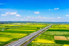 Aerial view of road passing through a rural landscape with bloom Royalty Free Stock Photo