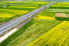 Aerial view of road passing through a rural landscape with bloom Royalty Free Stock Images