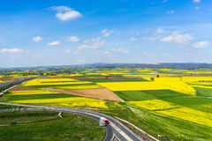 Aerial view of road passing through a rural landscape with bloom Stock Photos
