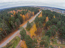 Aerial view of the road past the village cemetery. Shooting from height of the bird`s flight. Maksatikhinsky District, Tver Region Stock Photos
