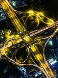 Aerial view Road roundabout with car lots in Thailand.street lar. Ge beautiful downtown at night.cityscape Royalty Free Stock Images