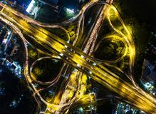 Aerial view Road roundabout with car lots in Thailand.street lar. Ge beautiful downtown at night.cityscape Royalty Free Stock Photo