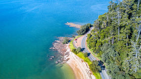 Aerial view on a road running along sea shore. Auckland, New Zealand. Royalty Free Stock Image