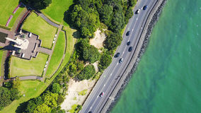 Aerial view on a road running along sea shore. Auckland, New Zealand. Royalty Free Stock Photos