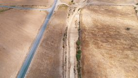Aerial view road in rural landscape stock footage