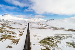 Aerial view of road and snowy mountains Royalty Free Stock Photo