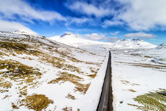 Aerial view of road and snowy mountains Stock Photo
