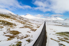Aerial view of road and snowy mountains Stock Images