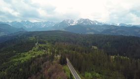 Aerial view of road in Tatras mountains forest stock video footage