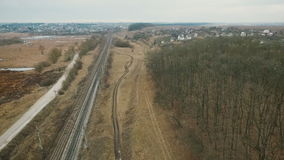 Aerial view: road, track, path, high-voltage network in Ukrainian field stock footage