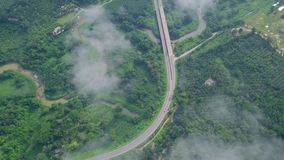 Aerial view of road in tropical countryside among limestone rocks. Top view of local villages in Krabi and Suratthani. Provinces, Thailand shot with a DJI Mavic stock video footage