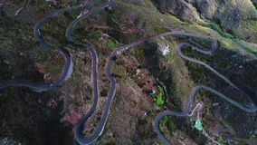 Road winding in mountains. Aerial view of road winding in mountains stock video