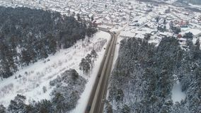 Aerial view of a road in winter landscape stock video footage