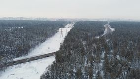 Aerial view of a road in winter landscape stock footage