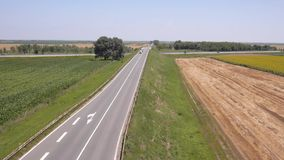 Aerial view on the roads, highway and agriculture fields stock footage