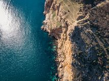 Aerial view of rock cliff at sea or ocean coastline, beautiful summer travel nature landscape.  stock photos
