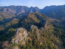 Aerial view of rocky cliffs in the mountain range. Aerial view of high rocky cliffs in the mountain range Royalty Free Stock Photography