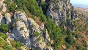 AERIAL VIEW. Rocky Formations On Slope Of Mountain stock footage