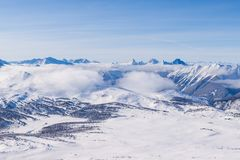 An aerial view of the Rocky Mountains in Alberta in winter Royalty Free Stock Photography