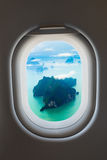 Aerial View of Rocky, Tropical Islands from a Passenger Window Royalty Free Stock Images