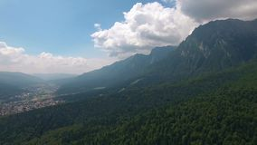 Aerial view of Romania mountains landscape town valley scenery stock video footage