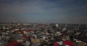Aerial view of Romanian city in a overcast day. Bird`s eye view over Romanian city of Galati in spring with Danube river in the background stock video footage
