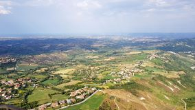 Aerial landscape Amazing view. Aerial view on roof, mountains and plans in italian territory royalty free stock image