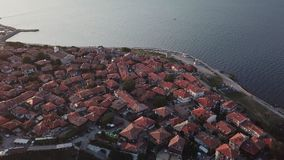 Aerial view of roofs old Nessebar, ancient city on the Black Sea coast of Bulgaria. UNESCO World Heritage, on sunset stock video footage