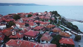 Aerial view of roofs old Nessebar, ancient city on the Black Sea coast of Bulgaria. UNESCO World Heritage, on sunset stock video