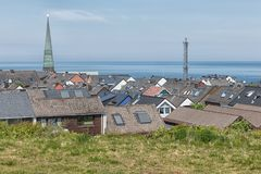Aerial view roofs of village German island Helgoland. With church tower and communication mast stock image