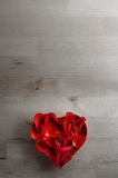 Aerial View of Rose Petals in Heart Shaped Bowl on Wood Royalty Free Stock Photo