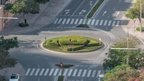 Aerial view of a roundabout circle road in Dubai downtown from above timelapse. Dubai, United Arab Emirates. Aerial view of a roundabout circle road in Dubai stock footage
