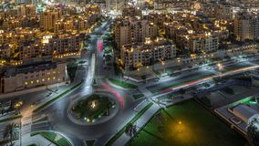 Aerial view of a roundabout circle road in Dubai downtown from above night timelapse. Dubai, United Arab Emirates. Aerial view of a roundabout circle road in stock video footage