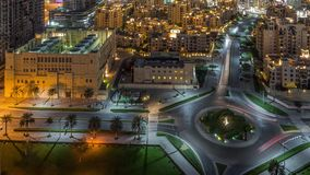 Aerial view of a roundabout circle road in Dubai downtown from above night timelapse. Dubai, United Arab Emirates. Aerial view of a roundabout circle road in stock video