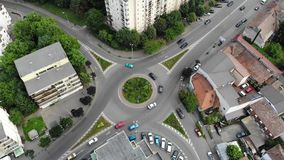 Aerial view of roundabout road and cars. Aerial view of roundabout road and cars traffic stock footage
