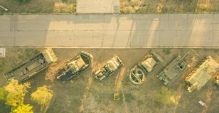 Aerial view of row of military vehicles machines during sunset d stock photos