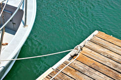 Aerial view of a rowbaot tied to a woden dock Royalty Free Stock Photo
