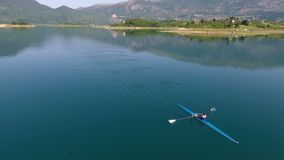 Aerial view of Rowing boat on lake.  stock footage