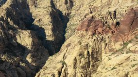 Aerial View of Rugged Rock Formations in Red Rock Canyon. Spectacular rock formations are found in Red Rock Canyon State Park just outside of Las Vegas, Nevada stock video footage