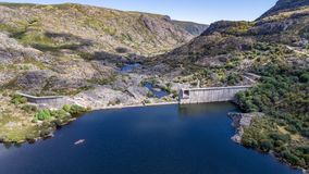 Aerial view of ruined dam on top of mountain Stock Images