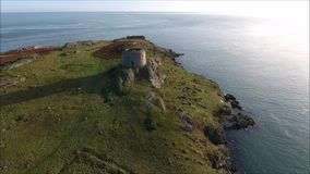 Aerial view. Ruins. Dalkey island. Ireland. Aerial view of the picturesque ruins of houses, chuch and Martello tower. Dalkey island. county Dublin. Ireland stock video footage