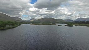 Aerial view of the ruins of historic Kilchurn Castle and Loch Awe. Argyl, Scotland stock video footage