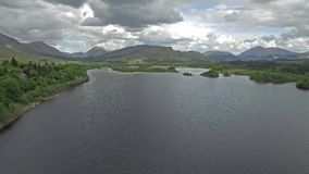 Aerial view of the ruins of historic Kilchurn Castle and Loch Awe. Argyl, Scotland stock footage