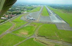 Aerial view of runway at Juan Santamaria International Airport, Costa Rica Royalty Free Stock Photo