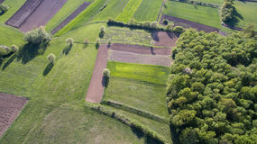 Aerial view of rural area. Aerial view of rural agricultural fields and forest shot with drone Royalty Free Stock Images