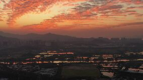 Aerial view of rural green fields in Hong Kong border and skylines in Shenzhen