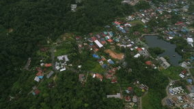 Aerial view of rural houses in the green mountain of Phuket city stock video