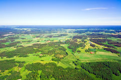 Aerial view of rural landscape. Aerial view of green rural landscape under blue sky Stock Image